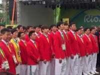 中国奥运代表团举行升旗仪式 五大洲朋友来相祝
