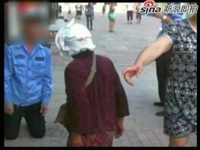 [视频]城管与七旬卖菜老太当街互跪称我也不容易